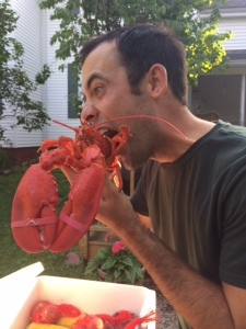 My love getting his lobster fix.